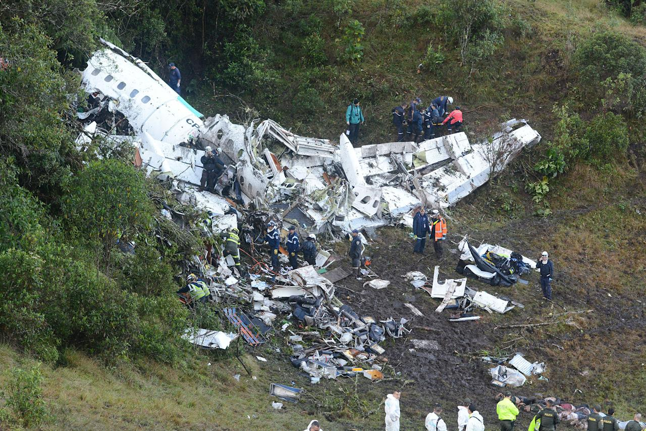 <p>Rescue workers search for survivors at he wreckage of a chartered airplane that crashed in La Union, a mountainous area outside Medellin, Colombia, Tuesday , Nov. 29, 2016. (AP Photo/Luis Benavides) </p>