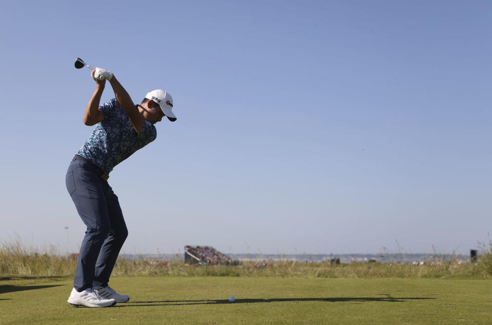 United States' Collin Morikawa hits shot from the 11 hole during the final round of the British Open Golf Championship at Royal St George's golf course Sandwich, England, Sunday, July 18, 2021. (AP Photo/Peter Morrison)