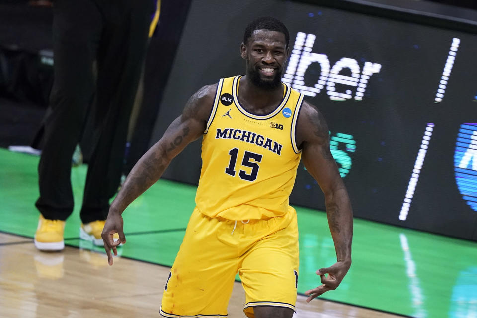 Michigan guard Chaundee Brown (15) celebrates after making a 3-point basket during the second half of a second-round game against LSU in the NCAA men's college basketball tournament at Lucas Oil Stadium Monday, March 22, 2021, in Indianapolis. (AP Photo/Darron Cummings)