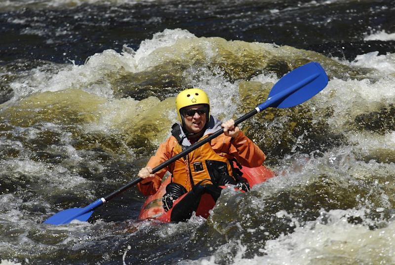 In this Aug. 24, 2013 photo provided by James Swedberg, Phil Brown maneuvers a ducky through the waves of the Blue Ledge Narrows in the Hudson River Gorge in Minerva, N.Y. The solo raft nearly unsinkable, doesn't require the skill of a true whitewater kayaker or canoeist. But it's the same intimate, wild view. (AP Photo/James Swedberg, James Swedberg)
