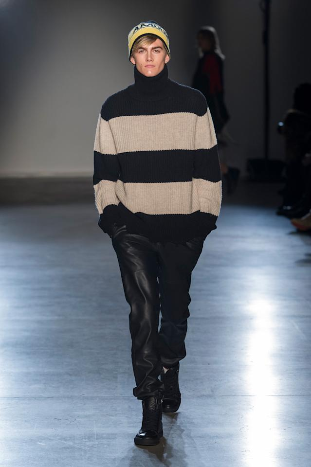 <p>Presley, son of top supermodel Cindy Crawford, continues his modeling streak wearing a neutral-colored striped sweater and leather pants. (Photo: ImaxTree) </p>