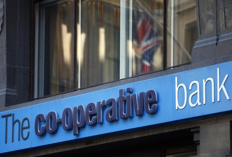 A Union Jack is reflected in a window of a branch of the Co-operative Bank in the City of London
