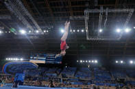 Jade Carey, of the United States, performs on the vault during the women's artistic gymnastic qualifications at the 2020 Summer Olympics, Sunday, July 25, 2021, in Tokyo. (AP Photo/Natacha Pisarenko)