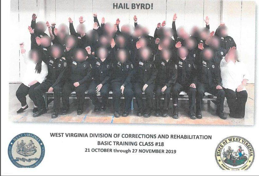 Government employees working for West Virginia's Division of Corrections and Rehabilitation make a Nazi salute in a class photo that surfaced in December.