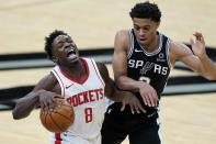 Houston Rockets forward Jae'Sean Tate (8) is fouled by San Antonio Spurs forward Keldon Johnson (3) during the second half of an NBA basketball game in San Antonio, Thursday, Jan. 14, 2021. (AP Photo/Eric Gay)