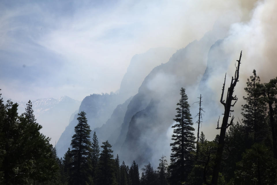 FILE - In this June 11, 2019, file photo, canyon walls are shrouded with smoke from a prescribed burn in Kings Canyon National Park, Calif. Wildfires burning in the U.S. this summer have upended plans for countless outdoor adventures. Campers, hikers, rafters and other outdoor enthusiasts have had to scrap or change plans or endure awful smoke. (AP Photo/Brian Melley, File)