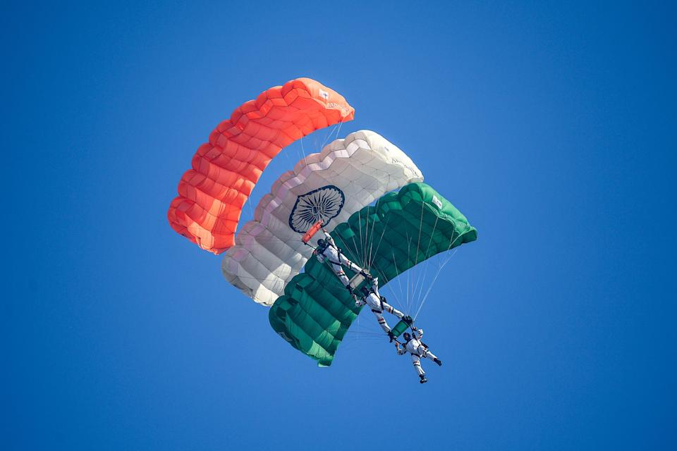 Indian Air Force (IAF) paratroopers from the 'Akashganga' skydiving team glide during the 88th Air Force Day parade at Hindon Air Force station in Ghaziabad on October 8, 2020. (Photo by Money SHARMA / AFP) (Photo by MONEY SHARMA/AFP via Getty Images)