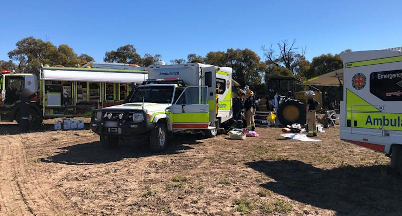 Queensland Ambulance Service paramedics, Queensland Fire and Emergency Service firefighters, and local medical professionals on the scene. Source: RACQ LifeFlight Rescue