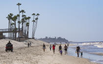 """SAN CLEMENTE, CA - MAY 05: Visitors walk on the beach south of the pier in San Clemente, CA on Tuesday, May 5, 2020. The city opened its beaches for daily active use after coordinating with Gov. Gavin Newsom""""u2019s office to maintain social distancing during the COVID-19 (coronavirus) lockdown. (Photo by Paul Bersebach/MediaNews Group/Orange County Register via Getty Images)"""
