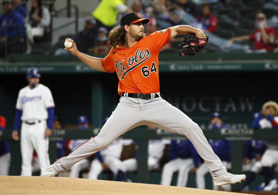 Baltimore Orioles starting pitcher Dean Kremer delivers to the plate against the Texas Rangers during the first inning of a baseball game in Arlington, Texas, Saturday, April 17, 2021. (AP Photo/Ray Carlin)