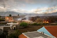 When the molten lava reaches the sea, experts warn it will send clouds of toxic gas into the air (AFP/DESIREE MARTIN)