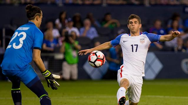 <p>Christian Pulisic of the USA attempts to chip a pass past Guillermo Viscarra of Bolivia late in the second half of an international friendly match at Children's Mercy Park on May 28, 2016 in Kansas City.</p>