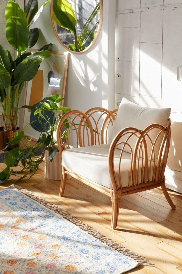 """<p>This <a href=""""https://www.popsugar.com/buy/Melody-Rattan-Chair-487383?p_name=Melody%20Rattan%20Chair&retailer=urbanoutfitters.com&pid=487383&price=229&evar1=casa%3Aus&evar9=45948314&evar98=https%3A%2F%2Fwww.popsugar.com%2Fphoto-gallery%2F45948314%2Fimage%2F46577040%2FMelody-Rattan-Chair&list1=shopping%2Cfurniture%2Cchairs%2Caffordable%20decor%2Cliving%20rooms%2Caffordable%20shopping&prop13=api&pdata=1"""" rel=""""nofollow"""" data-shoppable-link=""""1"""" target=""""_blank"""" class=""""ga-track"""" data-ga-category=""""Related"""" data-ga-label=""""https://www.urbanoutfitters.com/shop/melody-rattan-chair?category=chairs&amp;color=011&amp;type=REGULAR"""" data-ga-action=""""In-Line Links"""">Melody Rattan Chair</a> ($229) will add a bohemian touch to your space.</p>"""