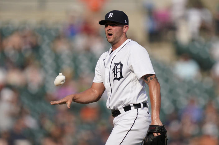 Detroit Tigers relief pitcher Alex Lange tosses the rosin bag during the fifth inning of a baseball game against the Chicago White Sox, Saturday, June 12, 2021, in Detroit. (AP Photo/Carlos Osorio)