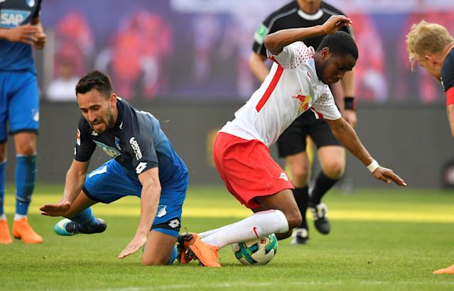 Soccer Football - Bundesliga - RB Leipzig vs TSG 1899 Hoffenheim - Red Bull Arena, Leipzig, Germany - April 21, 2018 RB Leipzig's Ademola Lookman in action with Hoffenheim's Lukas Rupp REUTERS/Matthias Rietschel DFL RULES TO LIMIT THE ONLINE USAGE DURING MATCH TIME TO 15 PICTURES PER GAME. IMAGE SEQUENCES TO SIMULATE VIDEO IS NOT ALLOWED AT ANY TIME. FOR FURTHER QUERIES PLEASE CONTACT DFL DIRECTLY AT + 49 69 650050