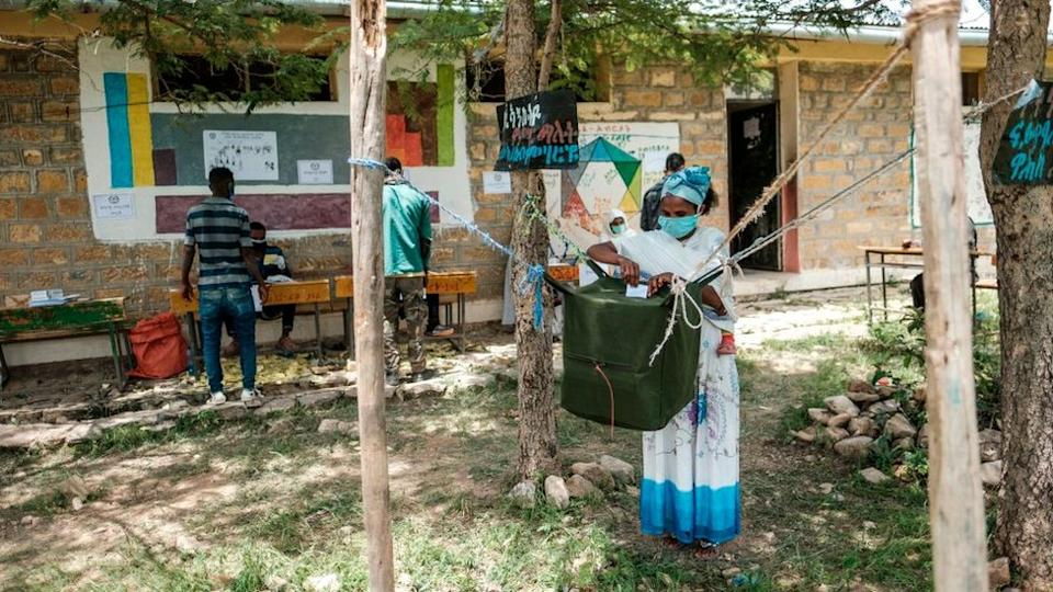 A woman casts her ballot at a polling station during Tigrays regional elections, in the town of Tikul, 15 kms east from Mekele, Ethiopia, on September 9, 2020.