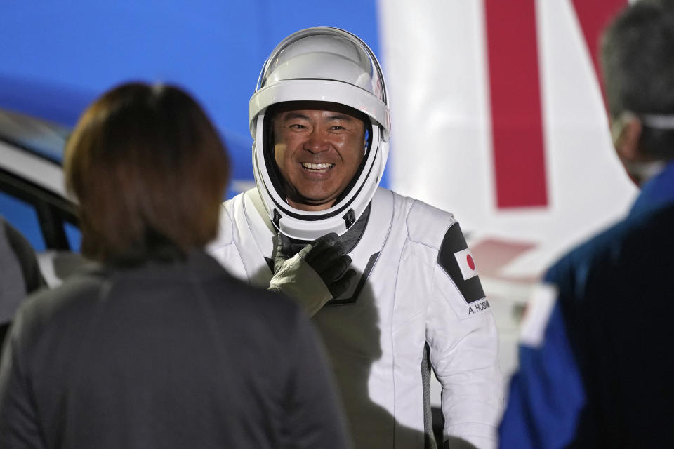 Japan Aerospace Exploration Agency astronaut Akihiko Hoshide smiles as he talks to family and friends after leaving the operations and checkout building before a launch attempt Friday, April 23, 2021, at the Kennedy Space Center in Cape Canaveral, Fla. Four astronauts will fly on the SpaceX Crew mission to the International Space Station scheduled for launch on April 23, 2021. (AP Photo/John Raoux)
