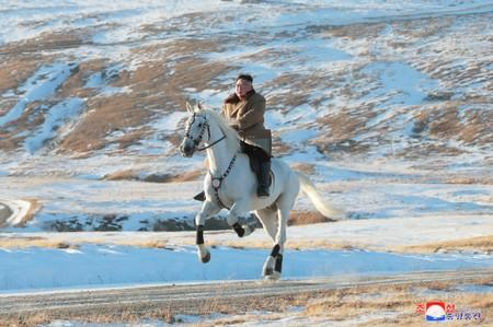 North Korean leader Kim Jong Un rides a horse during snowfall in Mount Paektu