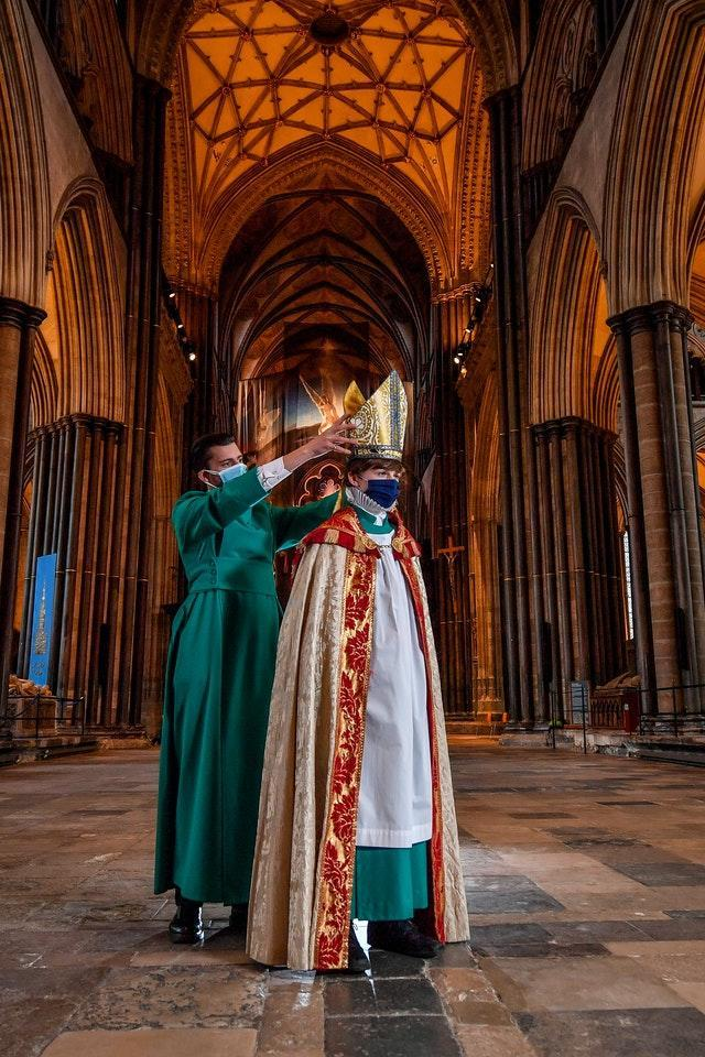 Verger Joseph Davies helps Chorister Bishop Sebastian Kunzer fit his mitre during rehearsal for the Feast of St Nicholas at Salisbury Cathedral (Ben Birchall/PA)