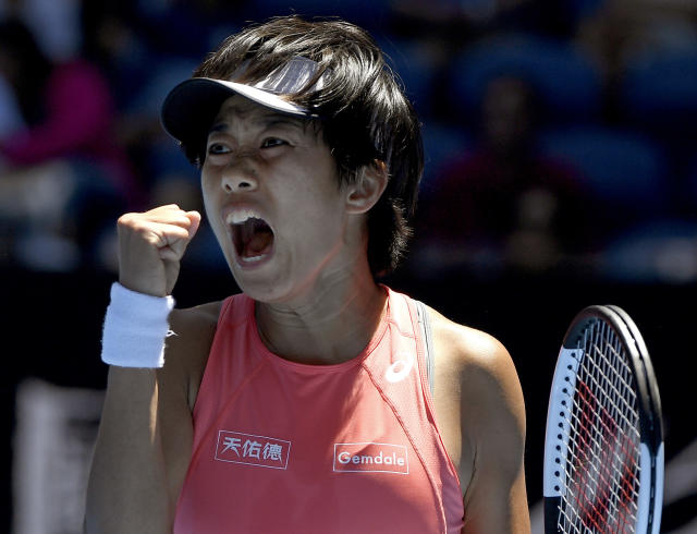 China's Zhang Shuai reacts after winning a point against Ukraine's Elina Svitolina during their third round match at the Australian Open tennis championships in Melbourne, Australia, Saturday, Jan. 19, 2019. (AP Photo/Andy Brownbill)