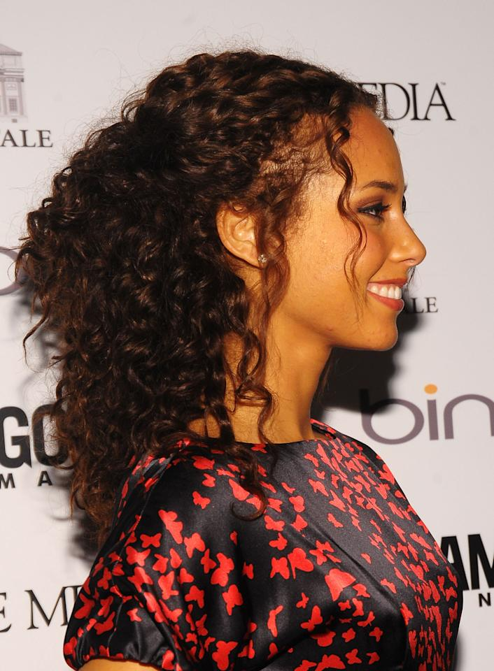 """<p>Attention, <a rel=""""nofollow"""" href=""""http://www.goodhousekeeping.com/beauty/hair/a34359/how-to-use-a-diffuser-curly-hair/"""">curly girls:</a> You can totally show off your spirals while still keeping your hair out of your eyes! Take a page from Alicia Keys' book and leave a few tendrils out in the front for a romantic touch.</p>"""