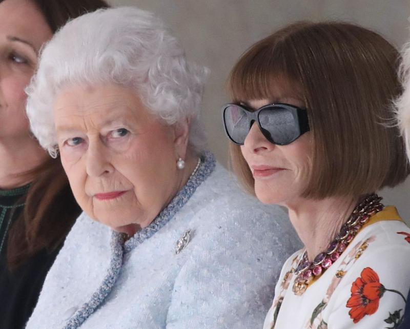 The pair took their seats, and the Queen's face said it all. Photo: Getty