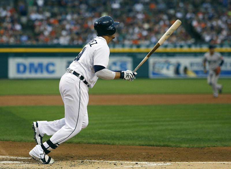 Detroit Tigers' Victor Martinez watches his grand slam in the first inning of a baseball game to take a 4-2 lead over the Boston Red Sox, Saturday, June 22, 2013, in Detroit. (AP Photo/Duane Burleson