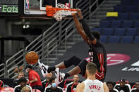 Miami Heat forward Bam Adebayo (13) slam dunks the ball over Toronto Raptors center Aron Baynes (46) during the second half of an NBA preseason basketball game Friday, Dec. 18, 2020, in Tampa, Fla. The Raptors are playing their home games in Tampa as a result of Canada's strict travel regulations stemming from the coronavirus pandemic. (AP Photo/Chris O'Meara)