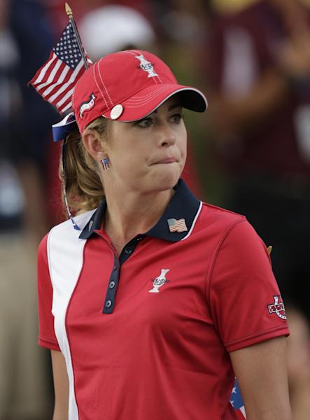 United States' Paula Creamer watches the the team from Europe celebrate after winning the Solheim Cup golf tournament, Sunday, Aug. 18, 2013, in Parker, Colo. (AP Photo/Chris Carlson)