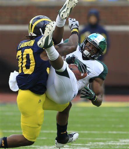 Michigan State wide receiver Bennie Fowler is upended by Michigan safety Thomas Gordon (30) after a 45-yard pass reception during the second quarter of an NCAA college football game at Michigan Stadium, Saturday, Oct. 20, 2012, in Ann Arbor, Mich. (AP Photo/Carlos Osorio)