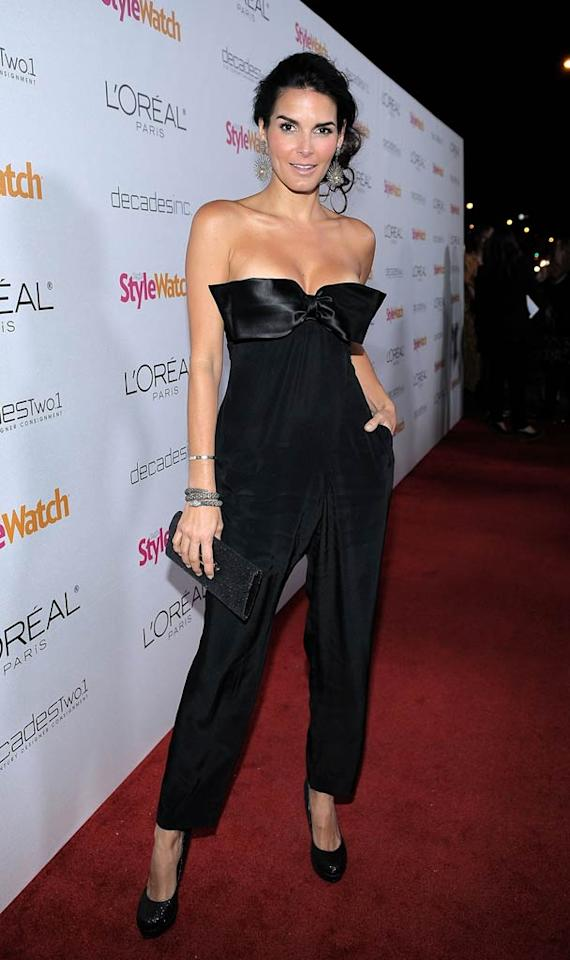 "What do you make of the daring, bow-adorned jumpsuit Angie Harmon rocked at the ""Night of Red Carpet Style"" soiree? We secretly love it, her loose ponytail, and those to-die-for chandelier earrings! Charley Gallay/<a href=""http://www.gettyimages.com/"" target=""new"">GettyImages.com</a> - January 27, 2011"