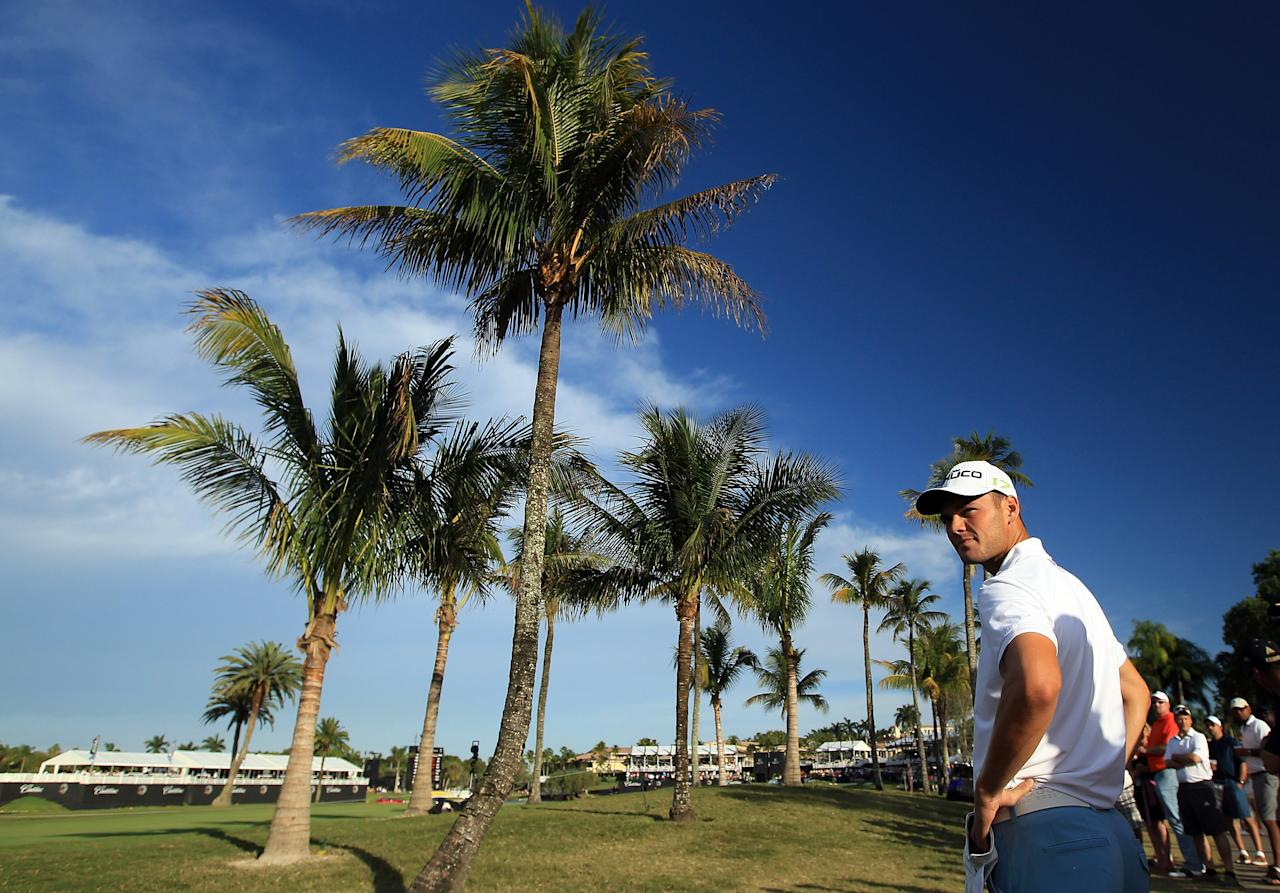 MIAMI, FL - MARCH 10:  Martin Kaymer of Germany plays his second shot at the par 4, 18th hole during the third round of the World Golf Championship Cadillac Championship on the TPC Blue Monster Course at Doral Golf Resort And Spa on March 10, 2012 in Miami, Florida.  (Photo by David Cannon/Getty Images)
