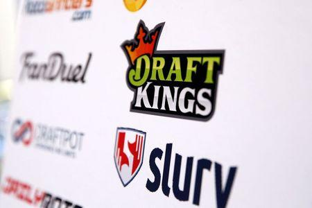 A DraftKings logo is displayed on a board inside of the DFS Players Conference in New York