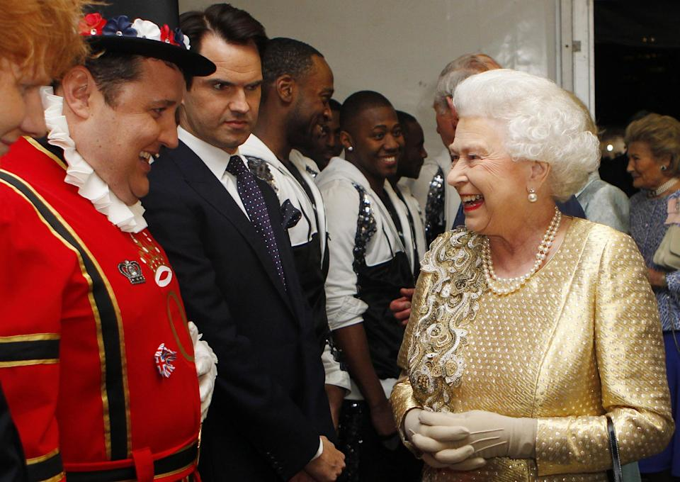 Kay meeting the Queen, as Jimmy Carr looks on. (PA)