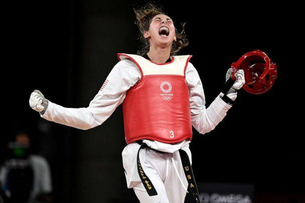 PHOTO: USA's Anastasija Zolotic celebrates winning the taekwondo women's -57kg quarter-final bout against Turkey's Hatice Kubra Ilgun during the Tokyo 2020 Olympic Games at the Makuhari Messe Hall in Tokyo on July 25, 2021. (Javier Soriano/AFP via Getty Images)