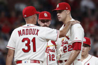 St. Louis Cardinals pitching coach Mike Maddux (31) talks with starting pitcher Jack Flaherty (22) as shortstop Paul DeJong (12) listens during the sixth inning of a baseball game against the Milwaukee Brewers Saturday, Sept. 14, 2019, in St. Louis. (AP Photo/Jeff Roberson)