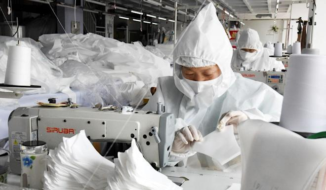In early March, China's daily output of face masks reached 116 million units. Picture: Xinhua