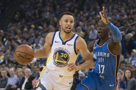 October 16, 2018; Oakland, CA, USA; Golden State Warriors guard Stephen Curry (30) dribbles the basketball against Oklahoma City Thunder guard Dennis Schroder (17) during the first quarter at Oracle Arena. Mandatory Credit: Kyle Terada-USA TODAY Sports