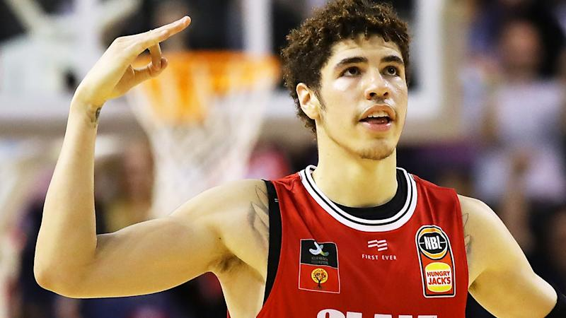 LaMelo Ball, pictured playing for the Illawarra Hawks in the NBL, became the youngest player in league history to record a triple-double on Monday.