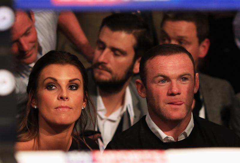 MANCHESTER, ENGLAND - SEPTEMBER 24: Manchester United and England footballer Wayne Rooney (R) and wife Coleen look on from ringside at Manchester Arena on September 24, 2016 in Manchester, England. (Photo by Ben Hoskins/Getty Images)