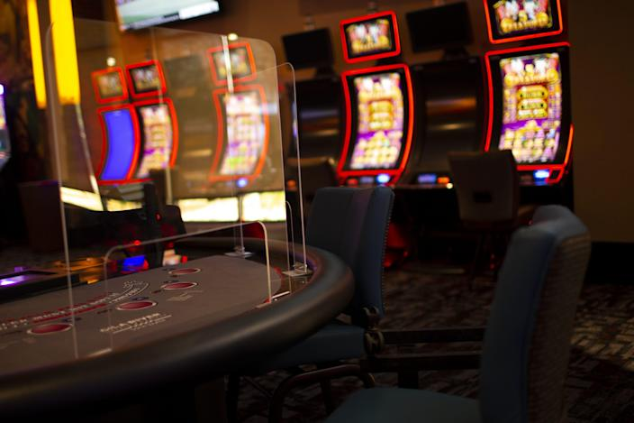 Plexiglas is placed around slot machines, gaming tables, and other areas at the Lone Butte Casino in Chandler on May 14, 2020. Casinos under the Gila River Indian Community were planning to reopen during the COVID-19 pandemic with new safety measures on May 15, 2020.