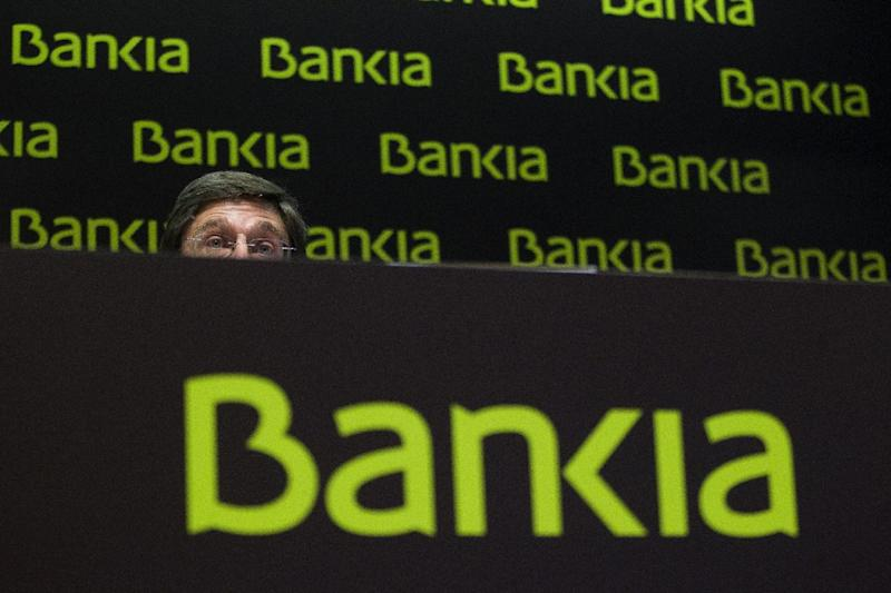 Bankia's president, Jose Ignacio Goirigolzarri, speaks during a press conference at the bank's headquarters in Madrid, Saturday, May 26, 2012. Spain's troubled bank, Bankia, has asked the Spanish government for 19 billion euro ($23.8 billion) in financial support just as a leading credit rating agency downgraded it to junk status. The request came as Standard & Poor's downgraded Bankia and four other Spanish banks to junk status because of uncertainty over restructuring and recapitalization plans. (AP Photo/Antonio Heredia)