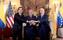 Colombian President Ivan Duque (C), US Vice President Mike Pence (R) and Venezuelan opposition leader and self-declared acting president Juan Guaido meet in Bogota on February 25, 2019