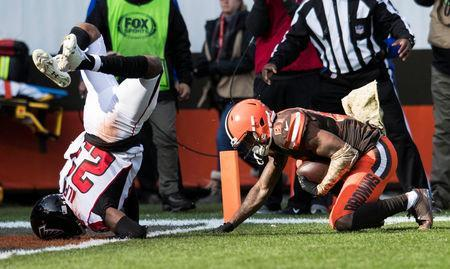 Nov 11, 2018; Cleveland, OH, USA; Atlanta Falcons cornerback Robert Alford (23) lands on his head after a defending a touchdown catch by Cleveland Browns wide receiver Rashard Higgins (81) during the first quarter at FirstEnergy Stadium. Mandatory Credit: Ken Blaze-USA TODAY Sports