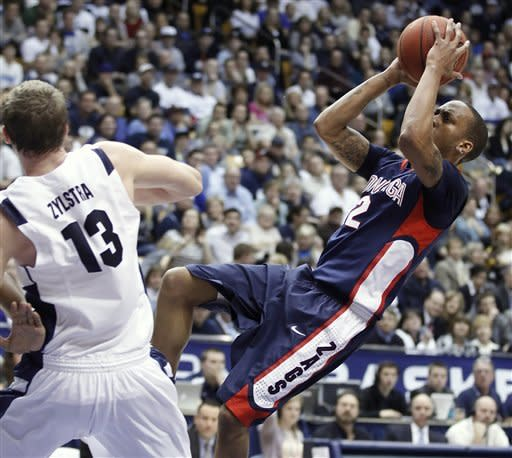 Gonzaga's Marquise Carter, right, takes a shot after he was fouled by BYU's Brock Zylstra during the first half of an NCAA college basketball game in Provo, Utah, Thursday, Feb. 2, 2012. (AP Photo/George Frey)