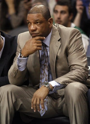 Boston Celtics coach Doc Rivers watches game action against the Phoenix Suns in the first half of an NBA basketball game, Friday, Feb. 22, 2013, in Phoenix. (AP Photo/Paul Connors)