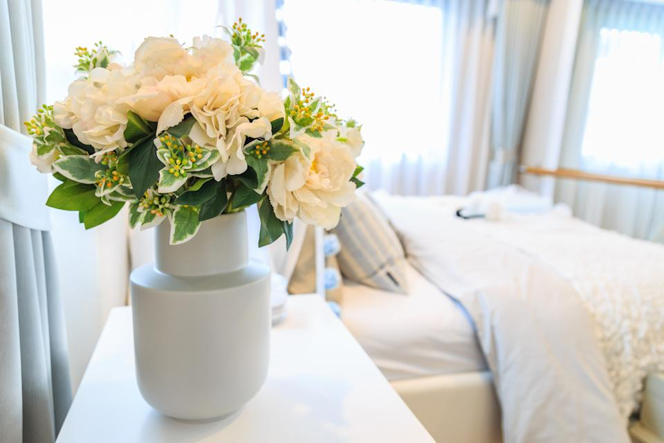 Consider swapping real flowers with artificial. (Getty Images)