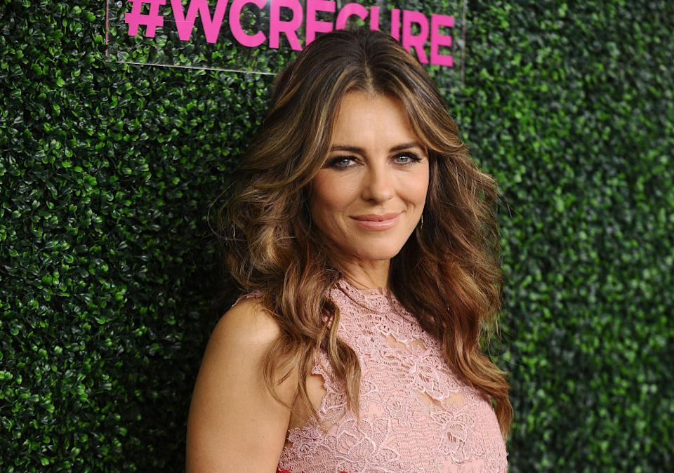 Elizabeth Hurley seems to be embracing the country life after sharing a video of herself rolling in the grass, pictured in 2017. (Getty Images)