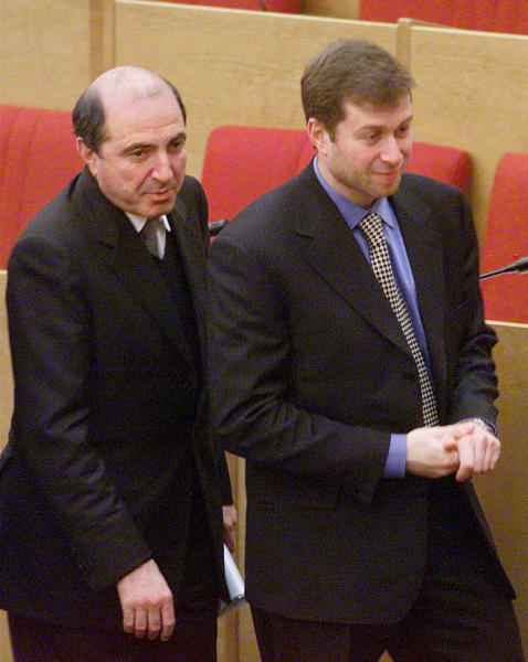 FILE - In this Jan. 26, 2000 file photo Russian tycoons Boris Berezovsky, left, and Roman Abramovich, then both lawmakers, walk after the session of the State Duma, parliament's lower house, in Moscow, Russia. United Kingdom police have said that Berezovsky has been found dead Saturday March 23, 2013. (AP Photo/Ivan Sekretarev, File)