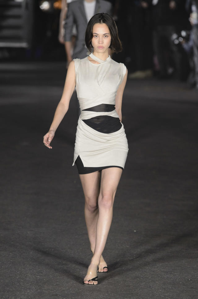 <p><i>A model in a black-and-white cut-out dress. (Photo: ImaxTree) </i></p>